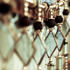 kittydesade: A series of hanging mirrors, gilt edged and diamond shaped, with gilt beads dangling. (mistress of mirrors)