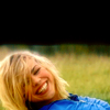 midnightjuly: rose tyler, lying on grass, smiling brightly (bad wolf)
