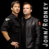 runpunkrun: john sheppard and rodney mckay standing very close together, in uniform, text: John/Rodney (john/rodney: boyfriends)