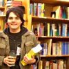 isweedan: Gerard (longish black hair) with a coffee and a thick book. In a Place of Books. (Gerard! At the Bookstore!/Library! - Ban)