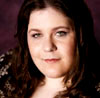 rachel_swirsky: A photo of Rachel Swirsky: She is a white woman with long brown hair. She is slightly smiling at the camera. (author photo, Rachel Swirsky)