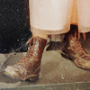 4077: brown combat boots worn with a peach dress (default) (Default)