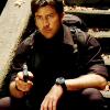 skieswideopen: John Sheppard sitting on stairs, aiming a gun (SG: John Sheppard)