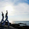 semielliptical: two women doing yoga by the sea shore (peace)