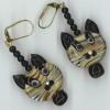 wyld_dandelyon: (birthday earrings)