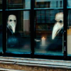 noctiluca: (faces in the window)