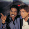 longwhitecoats: Lando Calrissian with his arm around Han Solo, pointing. (Friendship is magic)