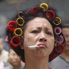 ironymaiden: Older Asian woman with curlers in her hair and a cigarette in her mouth. (hair)