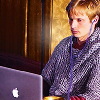 kabal42: Bradley James, wearing Arthur costume (chain mail) on a Macbook (Bradley - On laptop in armour)