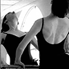 auroracloud: a woman in a black leotard bending backward in a dance practice, in front of a mirror that reflects her (dancer and mirror)