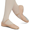 auroracloud: a dancer's calves and feet, wearing a pair of powder pink soft ballet slippers (ballet slippers)