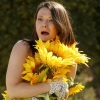 miss_s_b: Mindy St Clare from The Good Place, hiding her nakedness behind very large sunflowers and looking shocked (Feminist Heroes: Kate Beckett)