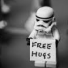 "jadesfire: Lego stormtrooper figure holding a sign that says ""free hugs"" (Free Hugs Stormtrooper)"