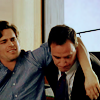 shameless2shoes: Neal, high, his arm over Peter's shoulder (Neal drugged on Peter (White Collar))