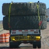 syntonic_comma: huge tires on flatbed trailer (travel)