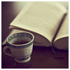 haptalaon: A calming cup of tea beside an open book (Default)