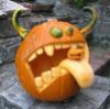 antisocialite_forum: Monster pumpkin sticks a big, pallid tongue out with a smaller jackolantern on it. His gourd eyes are bulging, and even his waterjug gourd horns are curled in disgust (I think Malik's getting sick of gourds..)