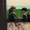 quietspring: Image: Hermione handing Harry some water, their backs turned to us as they travel down a road in the countryside. (harry and hermione by dess_xo)
