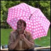 tommykaine: picture of mads mikkelsen in a boat, under a pink umbrella (mads)