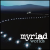 "dreamwriteremmy: a trail of lights on a dark landscape with hills at the horizon and the words: ""myriad worlds"" (myriad worlds)"