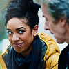 kaffyr: Bill smiles impishly at the Twelfth Doctor (Impish Bill and Twelve)