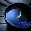 ateanalenn: A picture of the moon reflection in the water of a bowl (Default)