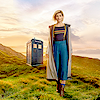 auroracloud: Thirteenth Doctor with green hills and the TARDIS behind her (Thirteen TARDIS)