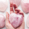 quartzwolf: A rose crystal heart in a hand (Heart Stone)