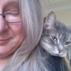 mschatelaine: Elaine with Ruby cat looking around her shoulder (Ruby shoulder)