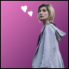 serenity_ribbon: An image of the 13th Doctor, on a pink background with heart doodles (13th doctor)