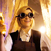muccamukk: Thirteen wearing googles and holding up her new sonic and grinning. (DW: A Little More Sonic)