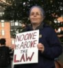 "redbird: photo of me holding a protest sign saying ""No one is above the law"" (protest sign)"