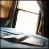 auguris: A blank notebook lying on a table. (writing)