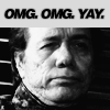 """meicdon13: Close up of man's deadpan face with an excited caption """"omg omg yay"""" (Excited)"""