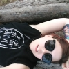 crimisin: A picture of me laying on a tree branch, I am wearing big sunglasses and a tank-hoodie that says never trust the living, (blackcraftcult, selfie, visible tattoo, witch tattoo)