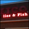 "cyprinella: broken neon sign that reads ""lies & fish"" (serious business)"