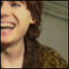 doorsclosingslowly: Nicky Wire in a leopard print coat, smiling, face half cut off (Nicky Wire)