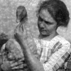 dragonlady7: black and white photograph of a woman holding a goose looking at it (mabel)