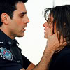 doranwen: the character Sam from Rookie Blue holding the face of character Andy (Rookie Blue)