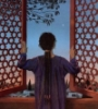 chestnut_filly: A young woman faces away form the viewer, looking out towards the evening star. The window shutters that frame her are carved with Jewish stars (Queen Esther)