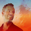 green: jr bourne smiling with a painted orange and blueish background (teen wolf: jr bourne)