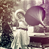 vicky_carter: Vintage photo of a woman listening to the music from a gramophone (Vintage woman and gramophone)