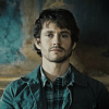 pearwaldorf: Will Graham sitting in front of a wall. His expression is blank. (hannibal - will wall)