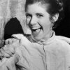 pearwaldorf: a b&w picture of Carrie Fisher in the Hoth outfit from ESB. She has a big grin on her face. (sw - carrie fisher) (Default)