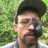 cassyblue: a scientist in a baseball cap with a large snail covering his right eye. (science)