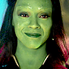 terresdebrume: A close up of Gamora from 'Guardians of the Galaxy'. She is looking at the camera with a happy but tearful smile. (bittersweet, emotional)