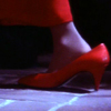 firecat: child's foot in adult's red high heeled shoe (nostalgia)