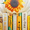 opensummer: Image of yellow books alternating with white books with a sunflower on top (sunflower book)