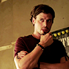 meridian_rose: Francois Arnaud (as Manfred in Midnight Texas), cupping his chin thoughtfully, (francois)