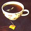 elucidate_this: a cup of tea with the tag f rom the bag visible (Default)